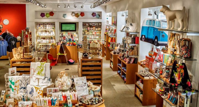 blanton museum shop interior - shelves, tables and windows full of colorful merchandise