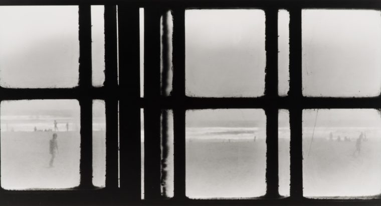 Image of a photograph by Fernando la Rosa featuring small groups of people gathered on a beach walking, laying down and playing in the water. Over top of the beach scene are horizontal and vertical black lines forming squares and thinner line shapes.