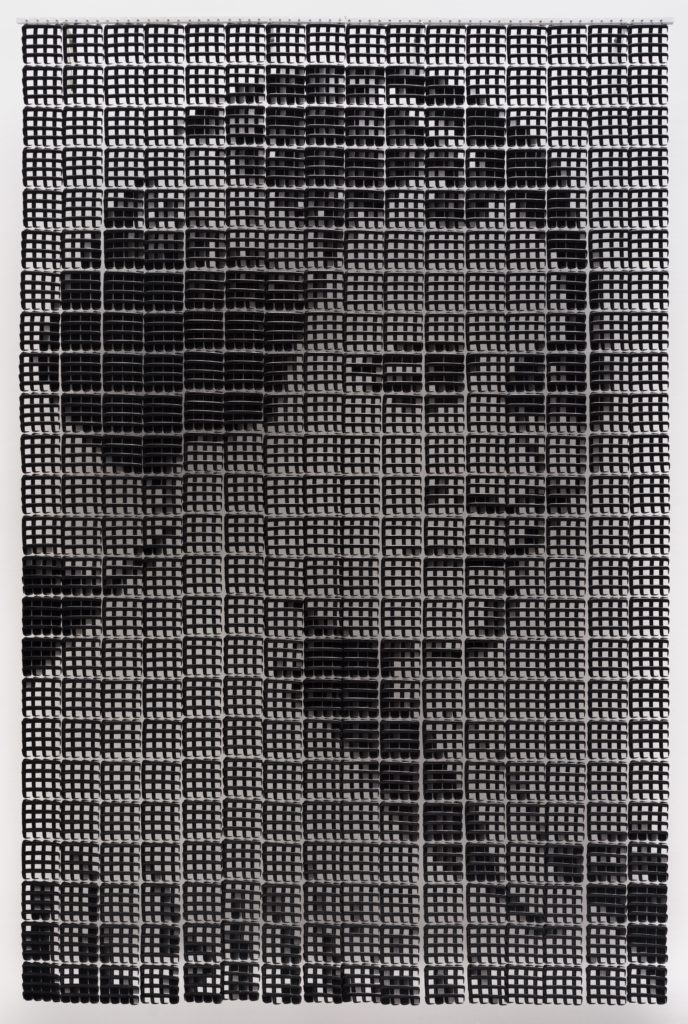 ten-foot portrait of Madam C.J. Walker made out of 3,840 fine-toothed pocket combs