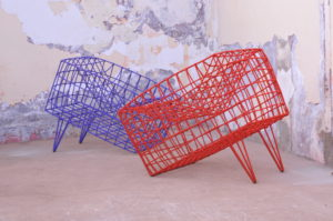 Red and blue chair like sculpture made of metal, nylon and cord