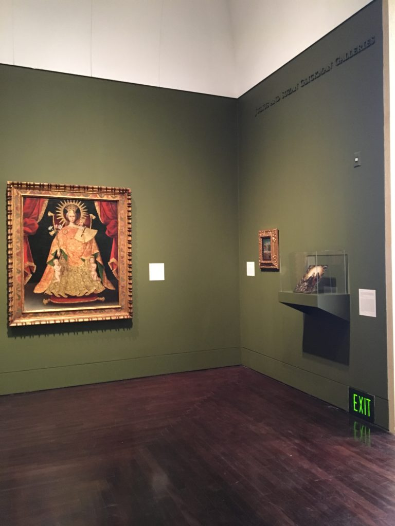 """Corner of the Art of the Spanish Americas Gallery at the Blanton Museum of Art, a painting titled """"Nuestra Señora de los Desamparados [Our Lady of the Forsaken]"""" is shown"""