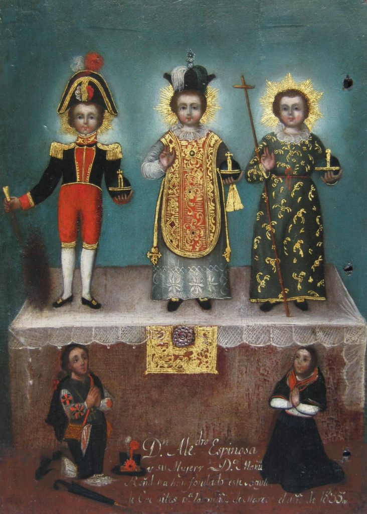 Three versions of the Christ child, each wearing a different costume
