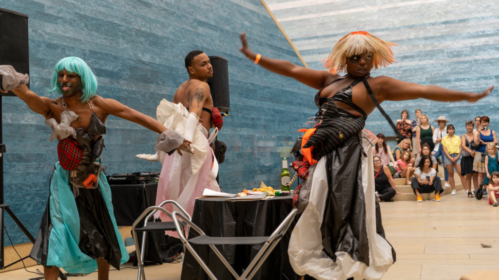 Photo of performance artists in the atrium of the Blanton Museum of Art