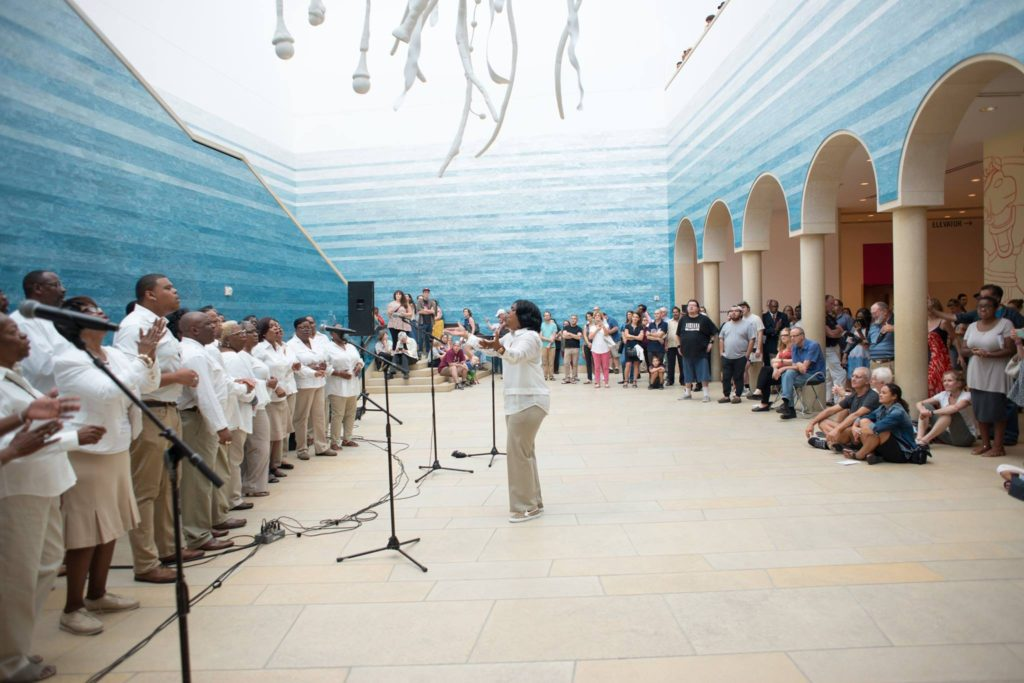 A choir singing in the atrium of the Blanton Museum of Art
