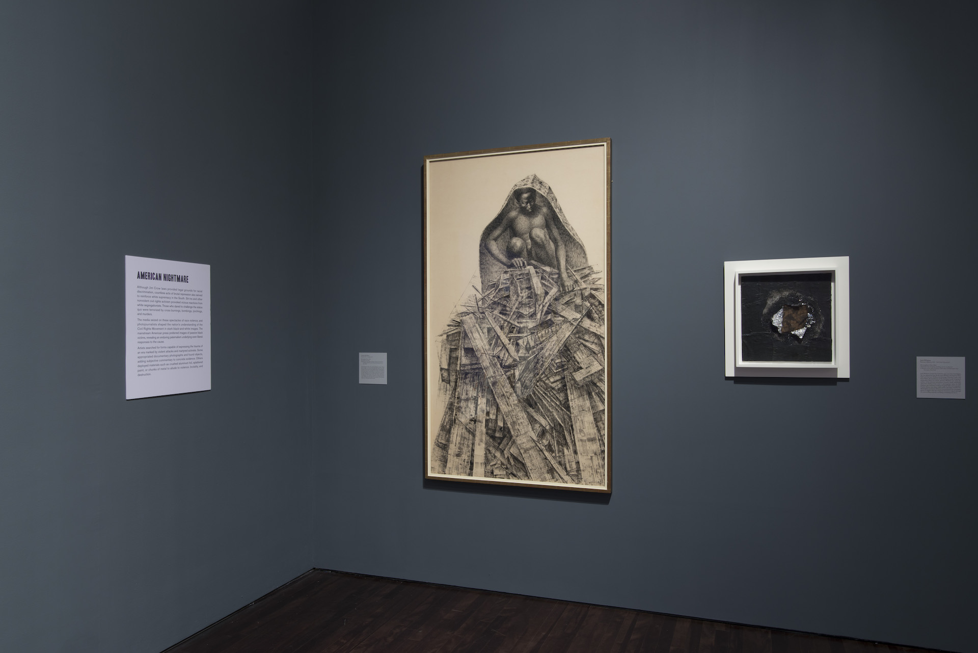 """View of the """"Witness: Art and Civil Rights in the Sixties"""" exhibition at the Blanton Museum of Art, two artworks are hung on the wall"""
