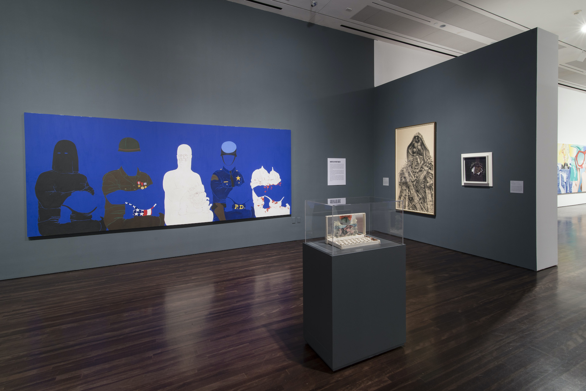 """Installation view of """"Witness: Art and Civil Rights in the Sixties"""" at theBlanton, several artworks are hung on the walls"""