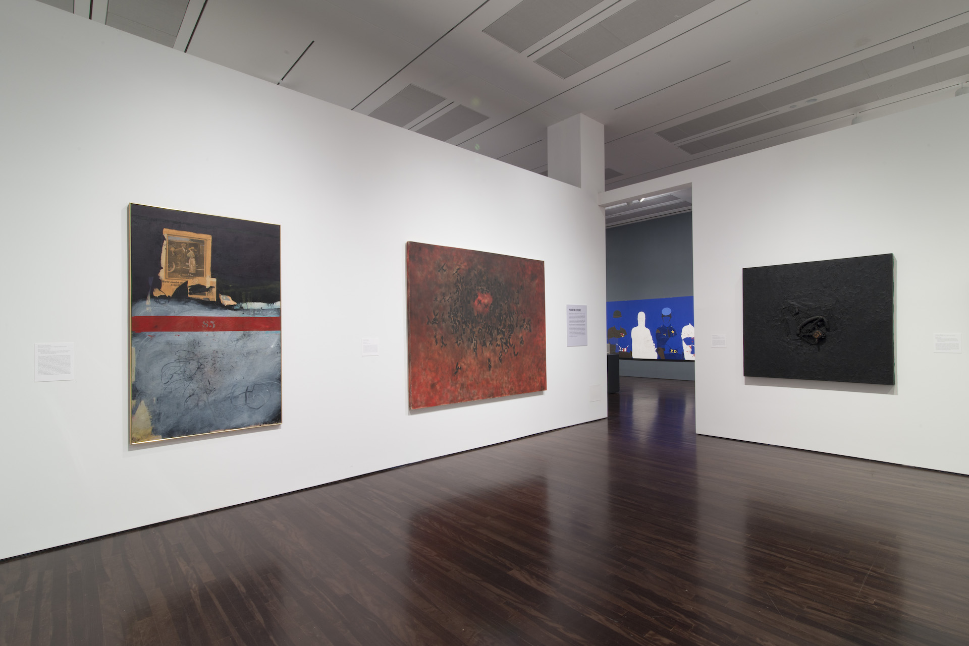 """Installation view of """"Witness: Art and Civil Rights in the Sixties"""" at theBlanton, several abstract artworks are hung on the gallery walls"""