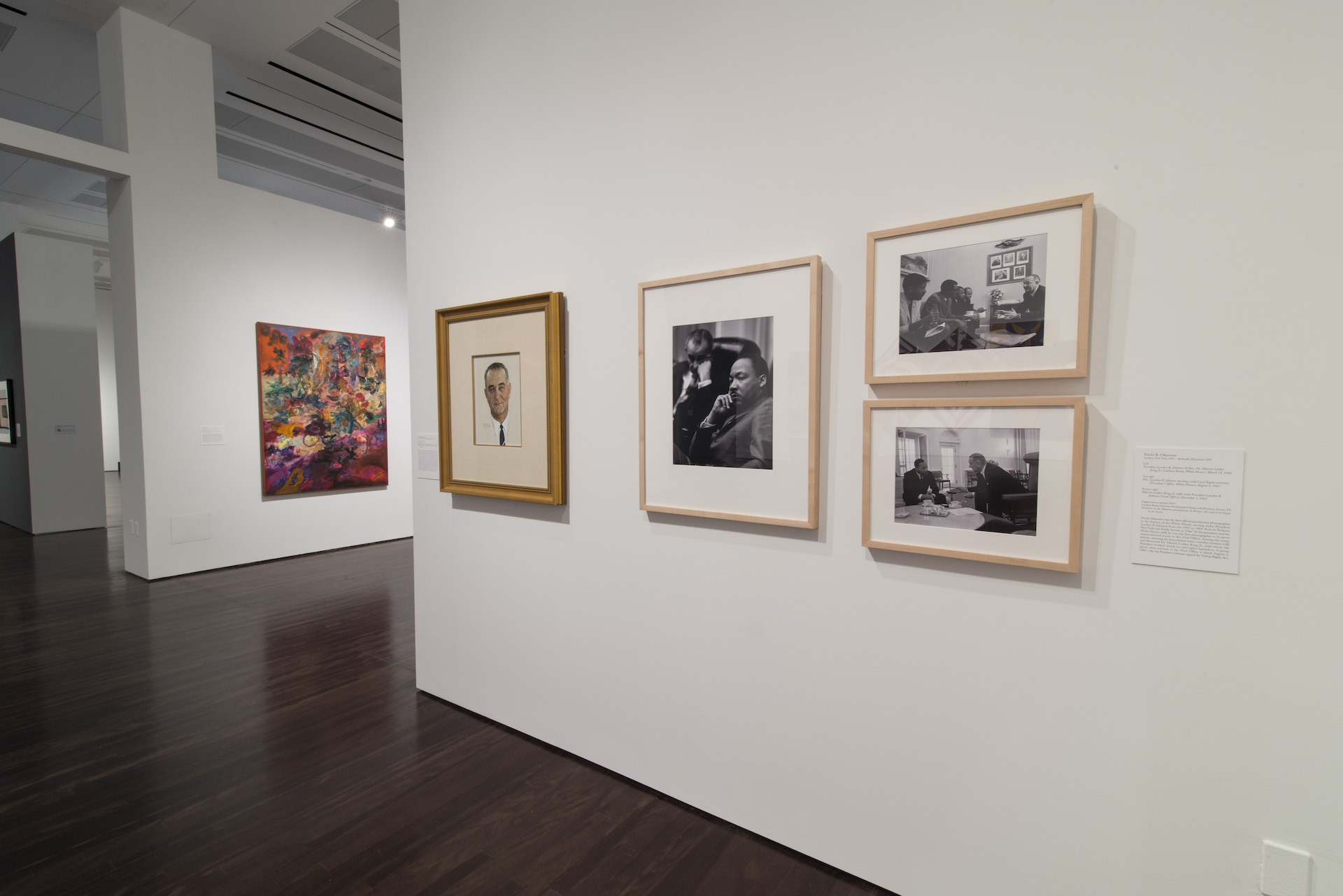"""Installation view of """"Witness: Art and Civil Rights in the Sixties"""" at theBlanton Museum of Art. 4 Photos featuring Martin Luther King Jr and Lyndon B Johnson are on display."""