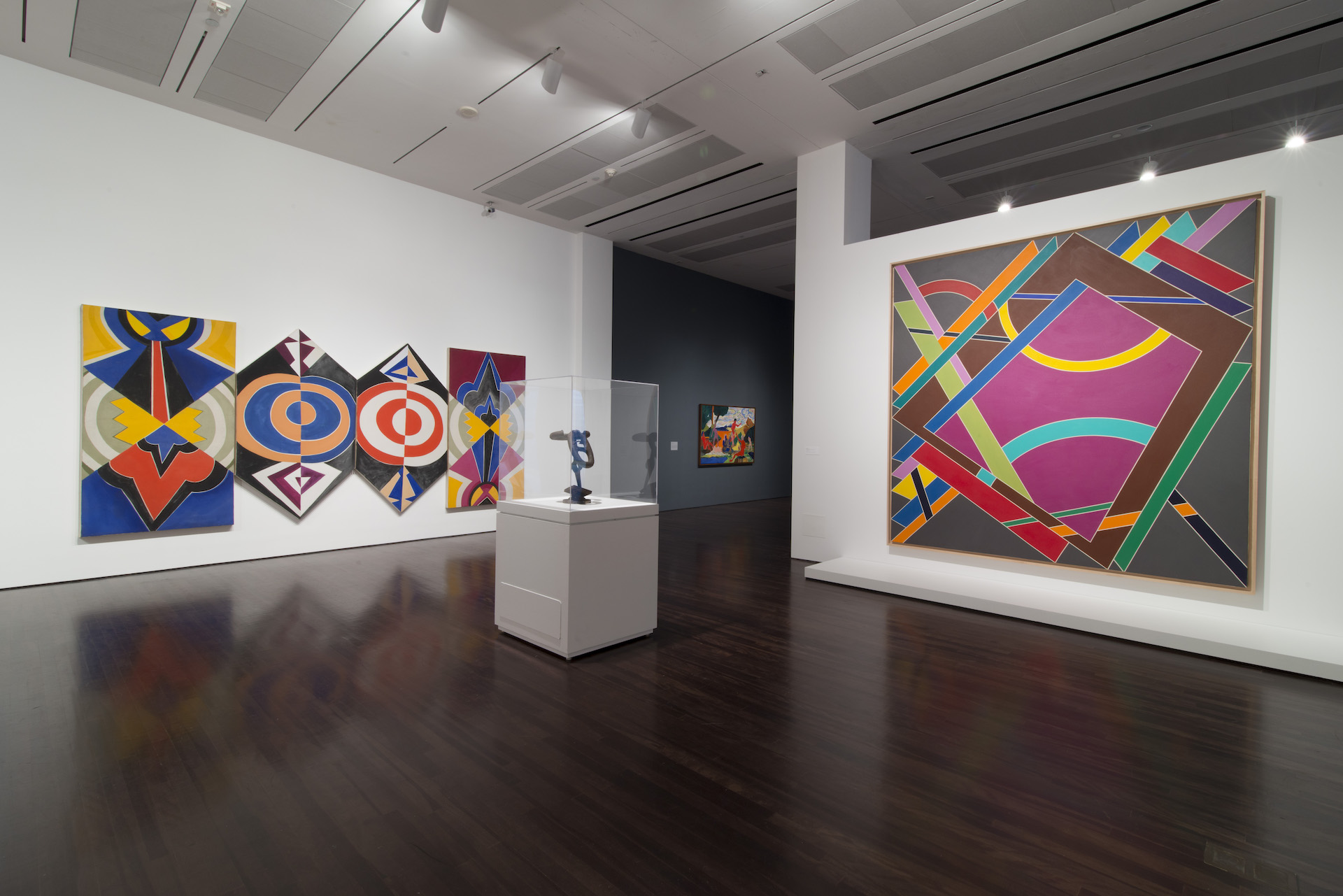"""Installation view of """"Witness: Art and Civil Rights in the Sixties"""" at theBlanton Museum of Art, The University of Texas at Austin. Artwork featured use vibrant colors and linework."""
