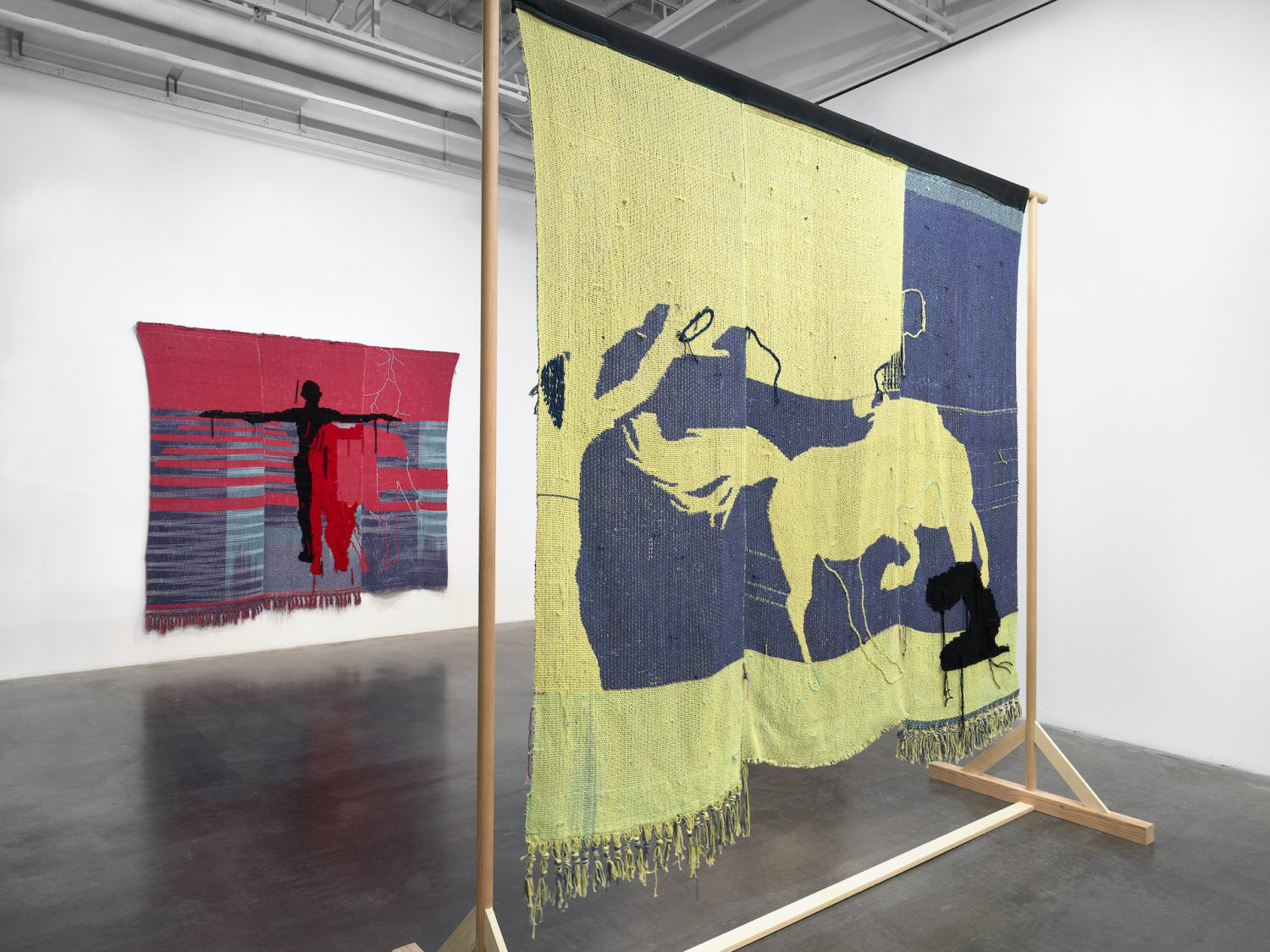 Diedrick Brackens: darling divined, 2019. Exhibition view. Woven tapestry featuring figures of humans and horses.