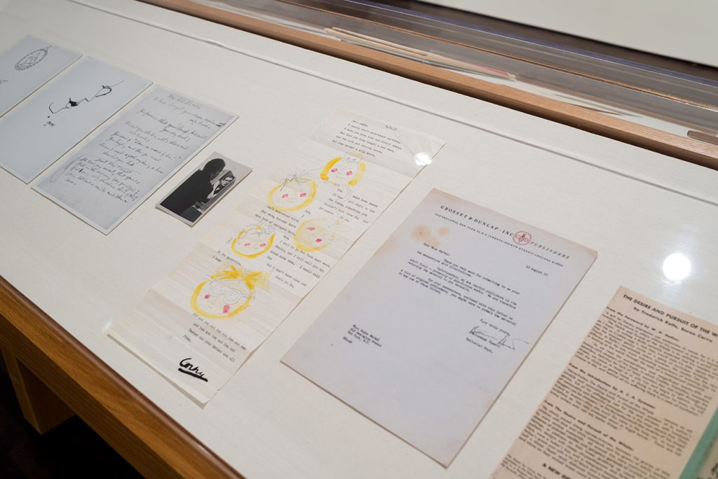 Prints and typed and handwritten letters in a display case