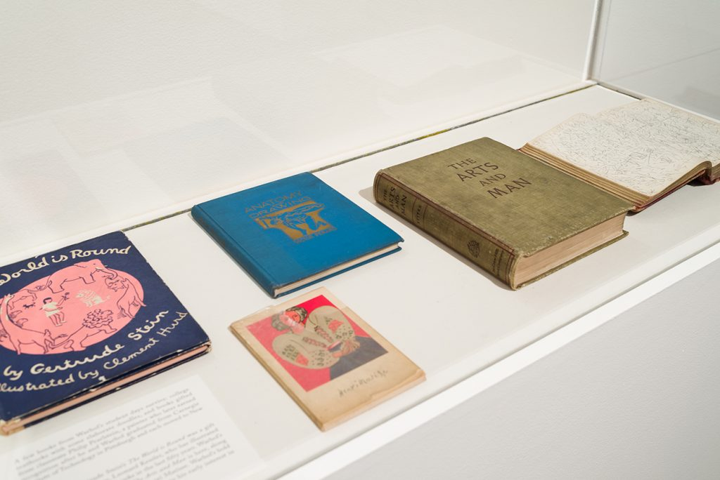 Printed books in a display case