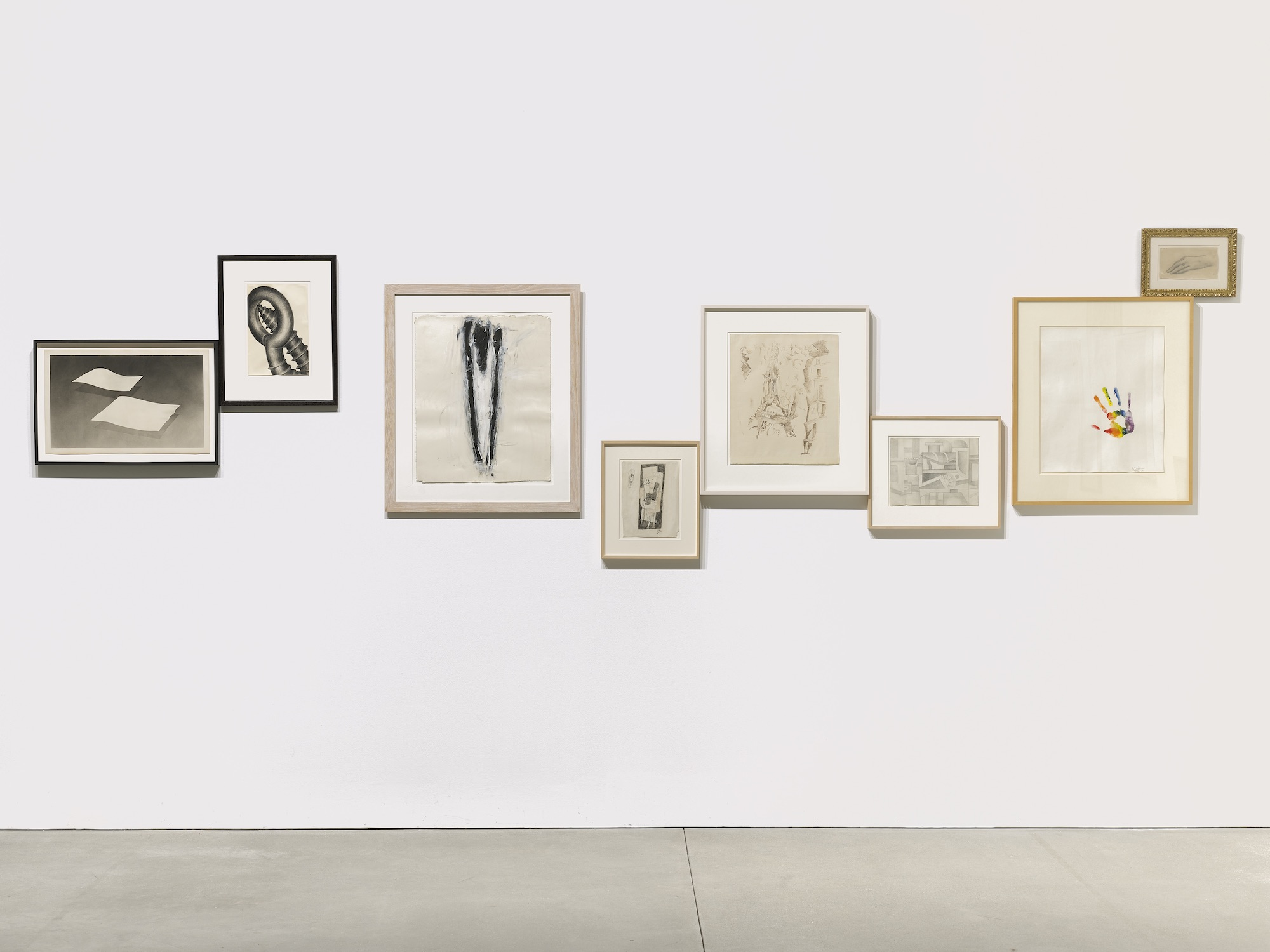 A selection of framed drawings on a wall from the collection of Jack Shear